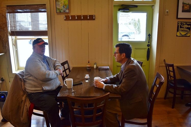 Council Member Donald meeting with a constituent at The Main Cup, Middletown.