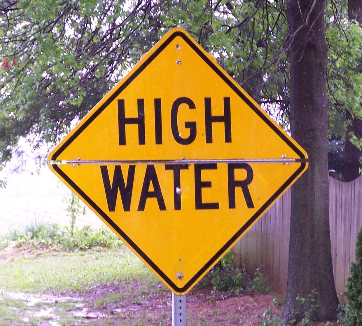 Flooded Road Warning Sign